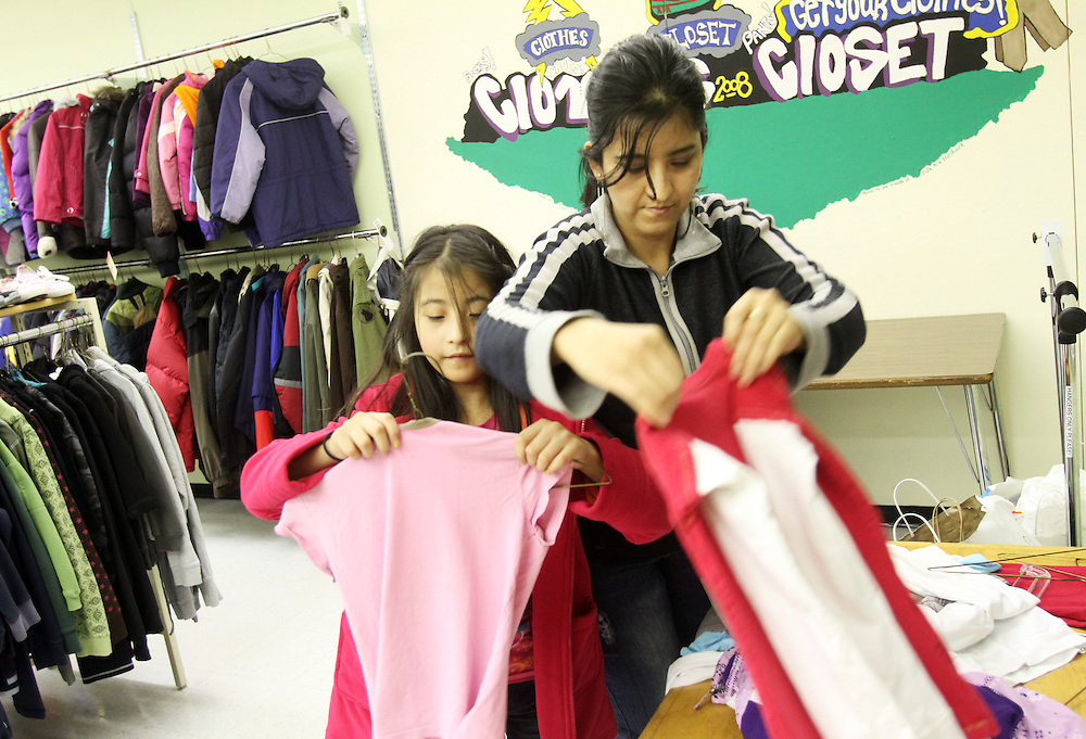 Galilea Muñiz looks through the racks with her mother, Dulce Lopez. The Beaverton School District has a Clothes Closet for students in need. Photographed Wednesday, Jan. 25, 2011.
