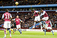 Jores Okore of Aston Villa (centre) clears with his head during the Barclays Premier League match at Villa Park, Birmingham<br /> Picture by Andy Kearns/Focus Images Ltd 0781 864 4264<br /> 01/01/2015