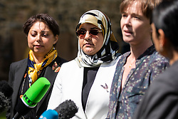 © Licensed to London News Pictures. 10/05/2018. London, UK. Fatima Boudchar (2-L) addresses the media outside Parliament after Attorney General Jeremy Wright announced that a settlement had been reached over her 2004 rendition to Libya. Fatima Boudchar and her husband, Abdel Hakim Belhaj, were kidnapped in Thailand in 2004 and flown to Libya in a rendition operation, allegedly with the help of MI6. Photo credit: Rob Pinney/LNP