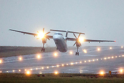 © Licensed to London News Pictures. 03/01/2018. Leeds, UK. A Fly Be aircraft is blown side ways during take off in strong winds this morning at England's highest airport, Leeds Bradford international as storm Eleanor batters the country. Photo credit: Andrew McCaren/LNP