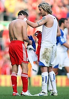 Photo: Paul Thomas.<br /> Liverpool v Blackburn Rovers. The Barclays Premiership. 14/10/2006.<br /> <br /> Craig Bellamy (L) of Liverpool is cogratulated by old Walesh team mate Robbie Savage.