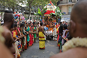 Women pulling the Ganesh float with long plant fibre ropes, in the parade celebrating the festival of Ganesh Chaturthi, marking the birth of the Hindu god Ganesha, on the streets of the La Chapelle area of the 18th arrondissement of Paris, France, on Sunday 1st September 2019. The annual religious festivities and parade take place near the Ganesha Temple of Paris, or Sri Manicka Vinayakar Alayam Temple, the largest Hindu temple in France. Ganesha is the elephant-headed Hindu God of Beginnings, son of Shiva and Parvati, who represents love and knowledge. Picture by Manuel Cohen
