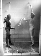 Upstate New York, a dormitory for delinquent boys taking a shower.