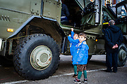 Brussels, Belgium 20160313 The Royal Belgian Military Academy had its yearly open day in Etterbeek, Brussels.The Royal Military Academy is a military institution of university education responsible for the basic academic, military and physical training of future officers.Two young boys in blue coat ask their father to be lifted in vehicle