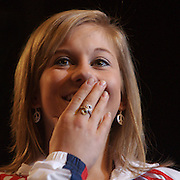 "Olympian Shawn Johnson seems embarrassed as she tells a story about how the pilot on a recent flight from Chicago to New York, had to be replaced because he hit his head after becoming excited that the Olympic champion was on his flight.  Johnson returned to her hometown of Des Moines, Iowa, Tuesday for a homecoming, attended by over 7,000 fans who filled the Wells Fargo Arena in Des Moines.   Johnson showed off her four Olympic medals, including a gold for the balance beam.  The city of Des Moines declared the month of September ""Shawn Johnson Month"".  As one of the most recognizable faces of the Beijing Olympics, Johnson has been on a whirlwind post Olympics tour, which has included an appearance on The David Letterman Show.  She will also appear on Jay Leno, and will lead the Pledge of Allegiance at this year's Democratic Convention."