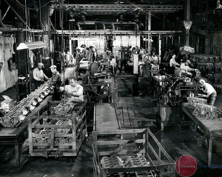 Studebaker Foundry workers prepare engine blocks for machining.
