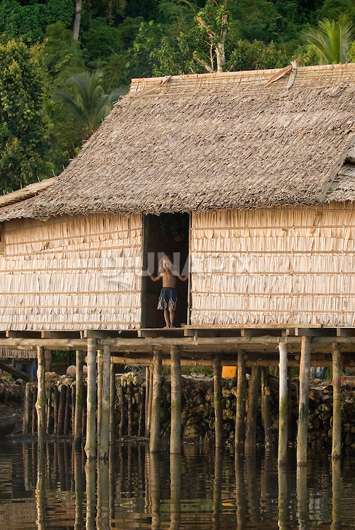 With a shortage of flat coastal land, the Kia community builds homes directly over their reef. While the setting is picturesque, chief Nelson Bako laments that fish immediately in front of the village are contaminated by sewage--as well as depleted. Fishermen paddle several hours to reach clean, productive fishing grounds.