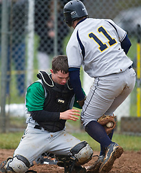 William Monroe catcher Jeremy Breeden (18) tags out Fluvanna first baseman Hunter Sheperd (11) at the plate.  The Fluvana County High School baseball team faced William Monroe HS at WMHS in Stanardsville, VA on April 15, 2009.  (Special to the Daily Progress / Jason O. Watson)