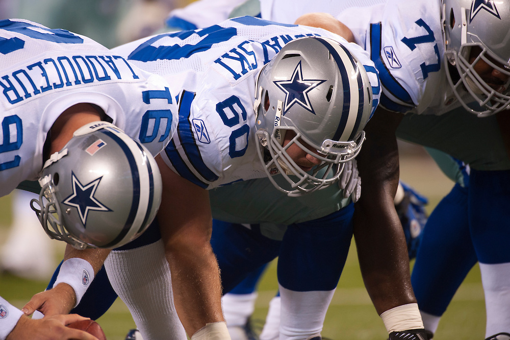 EAST RUTHERFORD, NJ - SEPTEMBER 11: The Dallas Cowboys offense on the line of scrimmage against the New York Jets  at MetLife Stadium on September 11, 2011 in East Rutherford, New Jersey. The Jets defeated the Cowboys 27 to 24. (Photo by Rob Tringali) *** Local Caption ***