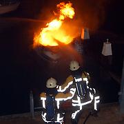 Speedboot in brand haven Huizen, vandalisme, brandstichting, pyromaan
