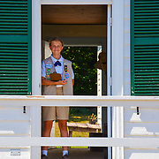 A dedicated girl scout mans her post at one of the historical sites on Mackinac Island, Michigan