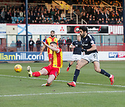 16th December 2017, Dens Park, Dundee, Scotland; Scottish Premier League football, Dundee versus Partick Thistle; Partick Thistle's Daniel Devine slices a clearance as Dundee's Sofien Moussa closes him down