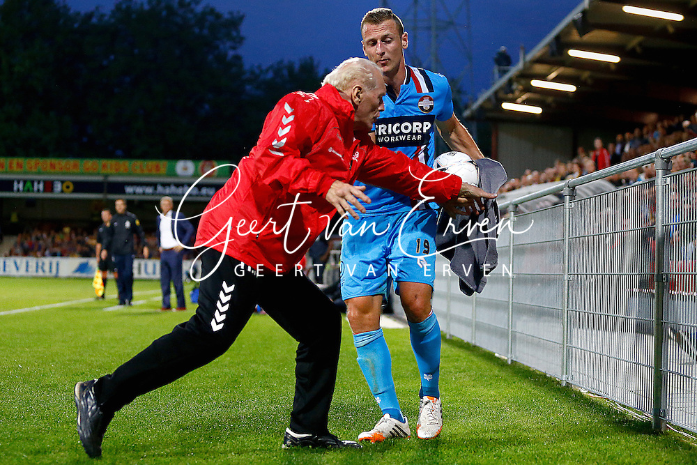 Onderwerp/Subject: Go Ahead Eagles - Willem II - Eredivisie<br /> Reklame:  <br /> Club/Team/Country: <br /> Seizoen/Season: 2014/2015<br /> FOTO/PHOTO: Masseur Henk NIJENHUIS (L) of Go Ahead Eagles clashes with Jonas HEYMANS (R) of Willem II as he uses a towel to wipe the ball. (Photo by PICS UNITED)<br /> <br /> Trefwoorden/Keywords: <br /> #03 $94 &plusmn;1401918380386<br /> Photo- &amp; Copyrights &copy; PICS UNITED <br /> P.O. Box 7164 - 5605 BE  EINDHOVEN (THE NETHERLANDS) <br /> Phone +31 (0)40 296 28 00 <br /> Fax +31 (0) 40 248 47 43 <br /> http://www.pics-united.com <br /> e-mail : sales@pics-united.com (If you would like to raise any issues regarding any aspects of products / service of PICS UNITED) or <br /> e-mail : sales@pics-united.com   <br /> <br /> ATTENTIE: <br /> Publicatie ook bij aanbieding door derden is slechts toegestaan na verkregen toestemming van Pics United. <br /> VOLLEDIGE NAAMSVERMELDING IS VERPLICHT! (&copy; PICS UNITED/Naam Fotograaf, zie veld 4 van de bestandsinfo 'credits') <br /> ATTENTION:  <br /> &copy; Pics United. Reproduction/publication of this photo by any parties is only permitted after authorisation is sought and obtained from  PICS UNITED- THE NETHERLANDS