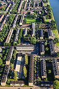 Nederland, Utrecht, Utrecht, 15-07-2012; de wijk Halve Maan, direct naast het Amsterdam-Rijnkanaal. De wijk maakt onderdeel van uit van het stadsdeel Oog en Al en stamt uit de  jaren vijftig, de wederopbouwperiode. Kenmerkend zijn laagbouw en portiek-flats. Omgeving Herderplein, boven het midden het Hugo de Grootplein..Halve Maan (Crescent) neighborhood, part of district Eye and Al. Low-rise flats and single-family houses. The neighborhood dates from the fifties, the post-war reconstruction period..luchtfoto (toeslag), aerial photo (additional fee required).foto/photo Siebe Swart