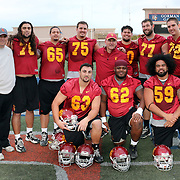 USC Interim Head Football Coach Clay Helton, Offensive Line Coach Mike Summers, and Coach James Cregg gather with the Trojan Offensive Line.  The USC Trojans practiced for the second day at Bishop Gorman High School in preparation for the Royal Purple Las Vegas Bowl to be held 12/21/13.   Photo by Barry Markowitz, 11/19/13, 4 pm
