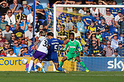 AFC Wimbledon defender Will Nightingale (5) tackling Shrewsbury Town defender Scott Golbourne (3) during the EFL Sky Bet League 1 match between AFC Wimbledon and Shrewsbury Town at the Cherry Red Records Stadium, Kingston, England on 14 September 2019.