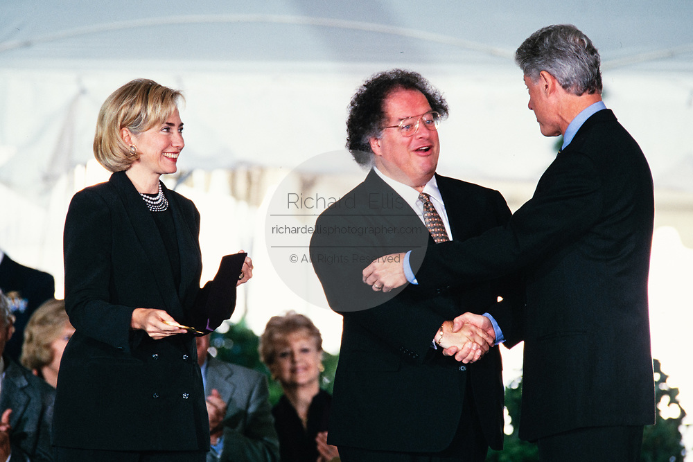 Music Director of the Metropolitan Opera James Levine is presented the National Medal of the Arts by President Bill Clinton and First Lady Hillary Clinton during a ceremony on the South Lawn of the White House September 29, 1997 in Washington, DC.