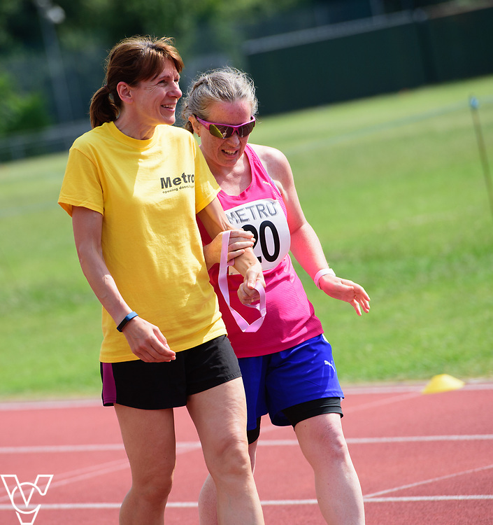 Metro Blind Sport's 2017 Athletics Open held at Mile End Stadium.  4x100m relay.  Lisa Hendy with guide runner<br /> <br /> Picture: Chris Vaughan Photography for Metro Blind Sport<br /> Date: June 17, 2017