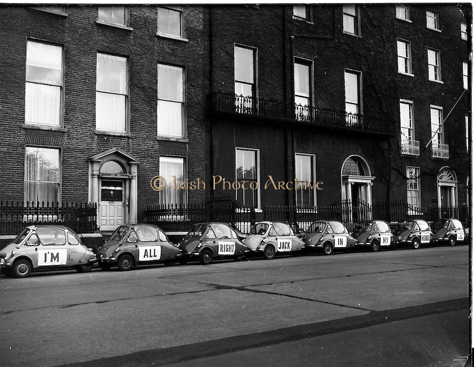 04/12/1960<br /> 12/04/1960<br /> 04 December 1960<br /> Heinkel &quot;I'm All Right Jack&quot; parade through Dublin city organised by Lincoln and Nolan. Picture shows the line of Heinkel Bubble cars on parade.