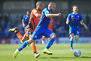 Ryan McLaughlin brings the ball forward during the EFL Sky Bet League 1 match between Rochdale and Wycombe Wanderers at Spotland, Rochdale, England on 19 April 2019.