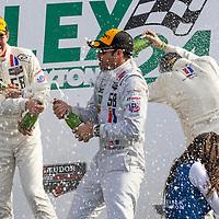 Daytona Beach, FL - Jan 25, 2015:  Patrick Dempsey (58) and his team celebrate after winning their division at the Rolex 24 at Daytona International Speedway in Daytona Beach, FL.
