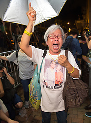 July 14, 2017 - Hong Kong, Hong Kong SAR, China - Protester ALEXANDRA WONG mourns, following the death in China of Nobel peace prize laureate Lui Xiaobo during a protest at the Central People's Government in the Hong Kong Special Administrative Region Liaison Office. Liu Xiaobo, the renegade Chinese intellectual who kept vigil at Tiananmen Square in 1989 to protect protesters from encroaching soldiers, promoted a pro-democracy charter that brought him a lengthy prison sentence and was awarded the Nobel Peace Prize while locked away, died under guard in a hospital on Thursday. He was 61. (Credit Image: © Jayne Russell via ZUMA Wire)