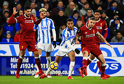 Steve Mounie of Huddersfield Town challenges Jordan Henderson of Liverpool - Mandatory by-line: Matt McNulty/JMP - 30/01/2018 - FOOTBALL - John Smith's Stadium - Huddersfield, England - Huddersfield Town v Liverpool - Premier League
