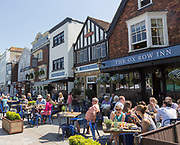 People sitting outside Ox Row Inn and Market Inn on sunny day, Market Place, Salisbury, Wiltshire, England, UK