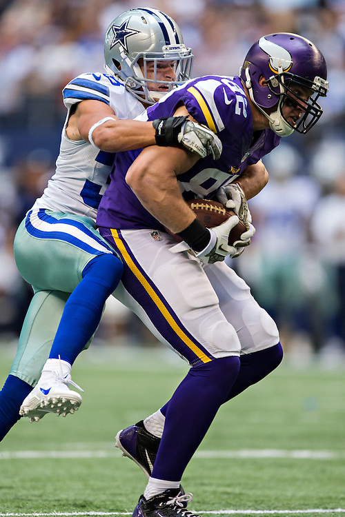 ARLINGTON, TX - NOVEMBER 3:  Kyle Rudolph #82 of the Minnesota Vikings is tackled by Jeff Heath #38 of the Dallas Cowboys at AT&T Stadium on November 3, 2013 in Arlington, Texas.  The Cowboys defeated the Vikings 27-23.  (Photo by Wesley Hitt/Getty Images) *** Local Caption *** Kyle Rudolph; Jeff Heath