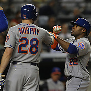 Eric Young Jr. (right), New York Mets, after hitting a home run is congratulated by Daniel Murphy at home plate during the New York Yankees V New York Mets, Subway Series game at Yankee Stadium, The Bronx, New York. 12th May 2014. Photo Tim Clayton