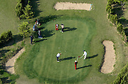 Chinese tourists play golf at a golf course in the North Korean capital of Pyongyang May 1, 2004. Photo by Lee Jae-Won (NORTH KOREA) www.leejaewonpix.com