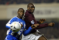 Photo: Chris Ratcliffe.<br />Arsenal v Wigan Athletic. Carling Cup. 24/01/2006.<br />Sol Campbell (R) and Jason Roberts tussle for the ball