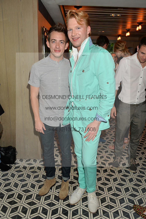 Left to right, KEVIN McHALE from Glee and HENRY CONWAY at Henry Conway's 31st birthday party held at the Pont St Restaurant, Belgraves Hotel, London on 12th July 2014.