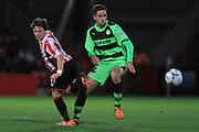 Jack Munns and Darren Carter during the Vanarama National League match between Cheltenham Town and Forest Green Rovers at Whaddon Road, Cheltenham, England on 21 November 2015. Photo by Antony Thompson.