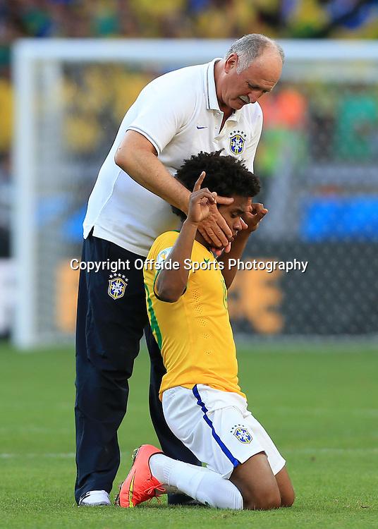 28th June 2014 - FIFA World Cup - Round of 16 - Brazil v Chile - Willian of Brazil celebrates with Brazil coach Luiz Felipe Scolari - Photo: Simon Stacpoole / Offside.