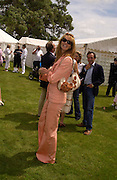 Elle Macpherson, Cartier Style Et Luxe, Goodwood, 27 June 2004. SUPPLIED FOR ONE-TIME USE ONLY-DO NOT ARCHIVE. © Copyright Photograph by Dafydd Jones 66 Stockwell Park Rd. London SW9 0DA Tel 020 7733 0108 www.dafjones.com