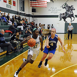TOM KELLY IV &mdash; DAILY TIMES<br /> DCS's Siani McNeil (32) drives past Christian Academy's Carli Sitkowski (4) during the, The Christian Academy at Delaware County Christian School girls basketball game on Friday afternoon, December 12, 2014.