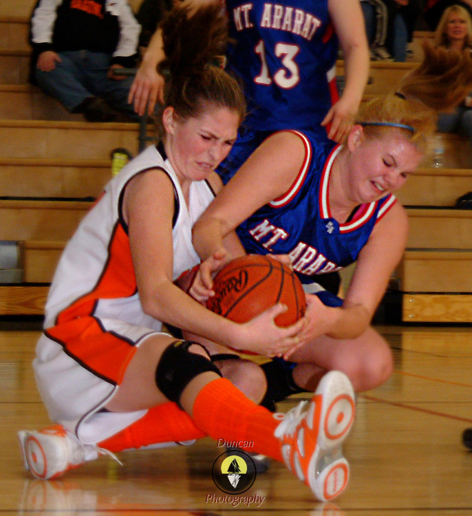 February 2, 2008 -- BATH, Maine.  Mariah George, left of Brunswick, and Ariel LeDuc scrap for the ball in Saturday afternoon's cross bridge rivalry game. Brunswick girls beat Mt. Ararat  43-28 at home. They never trailed. Photo by Roger S. Duncan.
