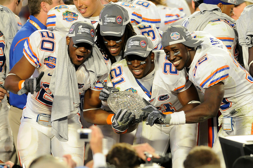January 8, 2009: Dorian Munroe, Moses Jenkins, Major Wright and Ahmad Black of the Florida Gators hold up the national championship trophy after the NCAA football game between the Florida Gators and the Oklahoma Sooners in the 2009 BCS National Championship Game. The Gators defeated the Sooners 24-14.