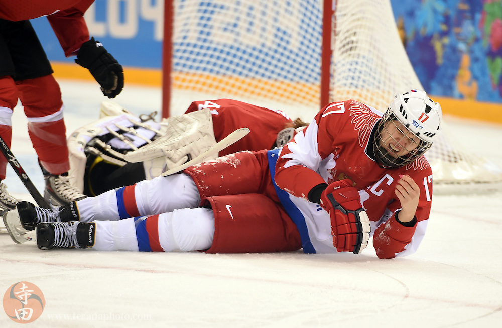 Feb 15, 2014; Sochi, RUSSIA; Russia forward Yekaterina Smolentseva (17) lays on the ice after colliding with Switzerland goalkeeper Florence Schelling (41) in a women's quarterfinals ice hockey game during the Sochi 2014 Olympic Winter Games at Shayba Arena.