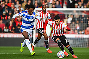 Brentford Forward Said Benrahma (21) and Queens Park Rangers Forward Eberechi Eze (10) battle for the ball during the EFL Sky Bet Championship match between Brentford and Queens Park Rangers at Griffin Park, London, England on 2 March 2019.