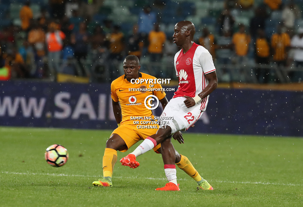 Mark Mayambela of Ajax Cape Town taking the ball away from George Maluleka of Kaizer Chiefs in the tackle during the 2016 Premier Soccer League match between Kaizer Chiefs and Ajax Cape Town held at the Moses Mabhida Stadium in Durban, South Africa on the 24th September 2016<br /> <br /> Photo by:   Steve Haag / Real Time Images