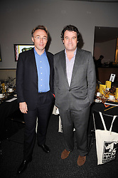 Left to right, TIM BUTCHER and ALASTAIR FOTHERGILL at a dinner in aid of Save The Rhino held at The Battlebridge Room, Kings Place, London N1 on 20th October 2010.