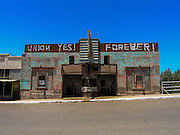 09 JULY 2005 - KEARNY, AZ: Pro union grafitti on an abandoned movie theater in Hayden, AZ during a strike against Asarco. Workers are claiming Asarco, now owned by Mexican conglomerate Grupo Mexico, is not bargaining in good faith.    PHOTO BY JACK KURTZ