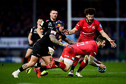 Elliot Daly of Saracens is challenged by Jack Nowell of Exeter Chiefs as he regains possession of the loose ball - Mandatory by-line: Ryan Hiscott/JMP - 29/12/2019 - RUGBY - Sandy Park - Exeter, England - Exeter Chiefs v Saracens - Gallagher Premiership Rugby