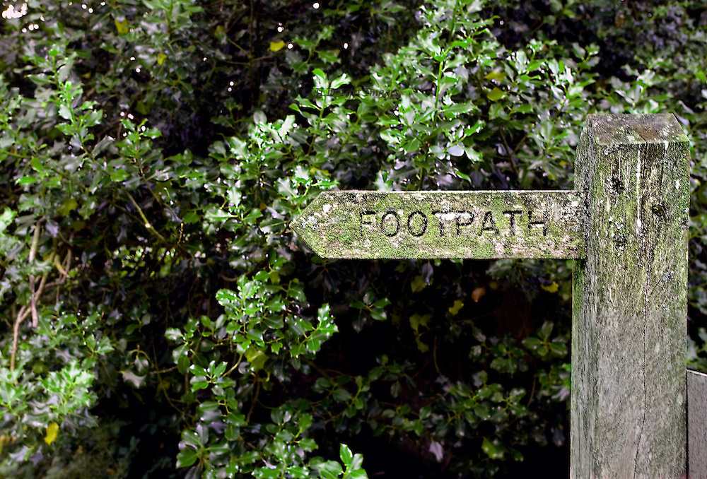 Kettlewell, Upper Wharfedale : wooden sign post pointing toward a footpath, information for hikers and walkers.
