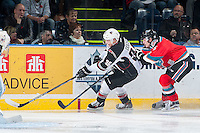KELOWNA, CANADA - NOVEMBER 11: Jonathan Smart #6 of Kelowna Rockets back checks Dakota Odgers #36 of Vancouver Giants on November 11, 2015 at Prospera Place in Kelowna, British Columbia, Canada.  (Photo by Marissa Baecker/ShoottheBreeze)  *** Local Caption *** Jonathan Smart; Dakota Odgers;