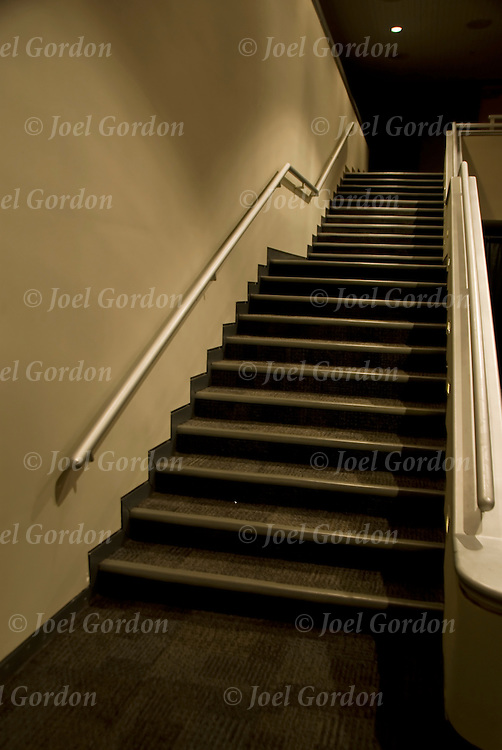 A stairway, giving the idea of an invitation to see what lies beyond, stairs leading up or down, to where?