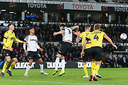 Derby County defender Craig Forsyth (3) is beaten to the ball by Millwall defender Alex Pearce (15) during the EFL Sky Bet Championship match between Derby County and Millwall at the Pride Park, Derby, England on 14 December 2019.