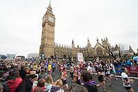 Competitors Run through Parliament Square & past Big Ben.<br /> The Virgin Money London Marathon, Sunday 26th April 2015.<br /> <br /> Photo: Thomas Lovelock for Virgin Money London Marathon<br /> <br /> For more information please contact Penny Dain at pennyd@london-marathon.co.uk